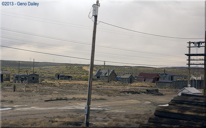 Riding by some very old buildings in Hanna, WY.