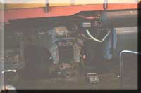 in the roundhouse, we see a traction motor being removed from a Chessie GP40-2. The traction motor will be removed and the locomotive pulled out from above it. A crane will lift the T-motor and another will be put in its place!