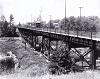 HRER #210 crossing the Sixteen Mile Creek bridge in Downtown Oakville, circa 1909.