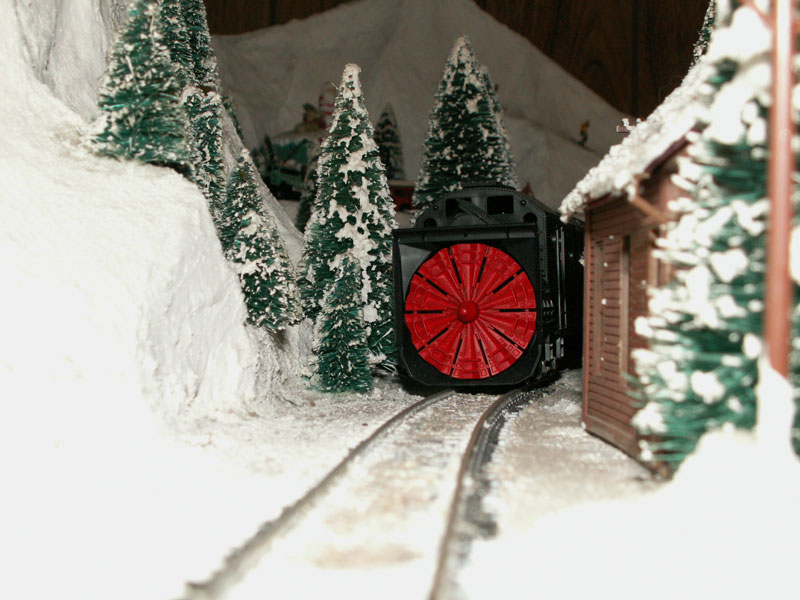 A rotary snowplow on the track behind the Lone Wolf Cafe