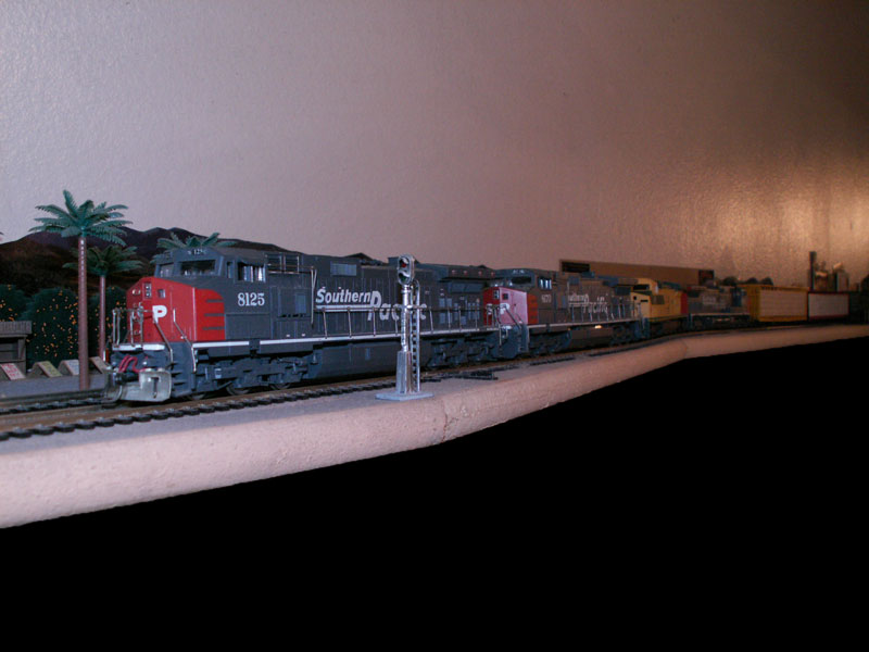 Southern Pacific freight train with lumber passes  through Redlands