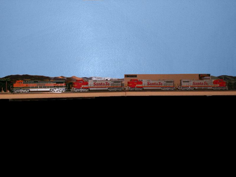A group of Santa Fe C44-9w is lead by a Burlington Northern Santa Fe locomotive