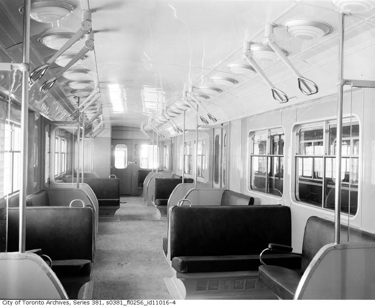 interior view of subway car showing openable windows and pull down hand holds divided for two. Black Bedroom Furniture Sets. Home Design Ideas