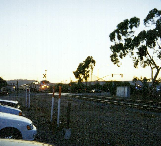 Amtrak Coast Starlight 14: (81K) At Sunset, #11 Crosses Milpas St. CLICK HERE To Hear
